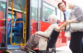 young man helping the senior couple in riding the bus