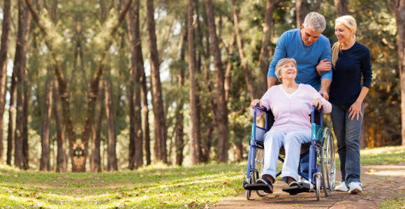 caregivers with their patient strolling in the park