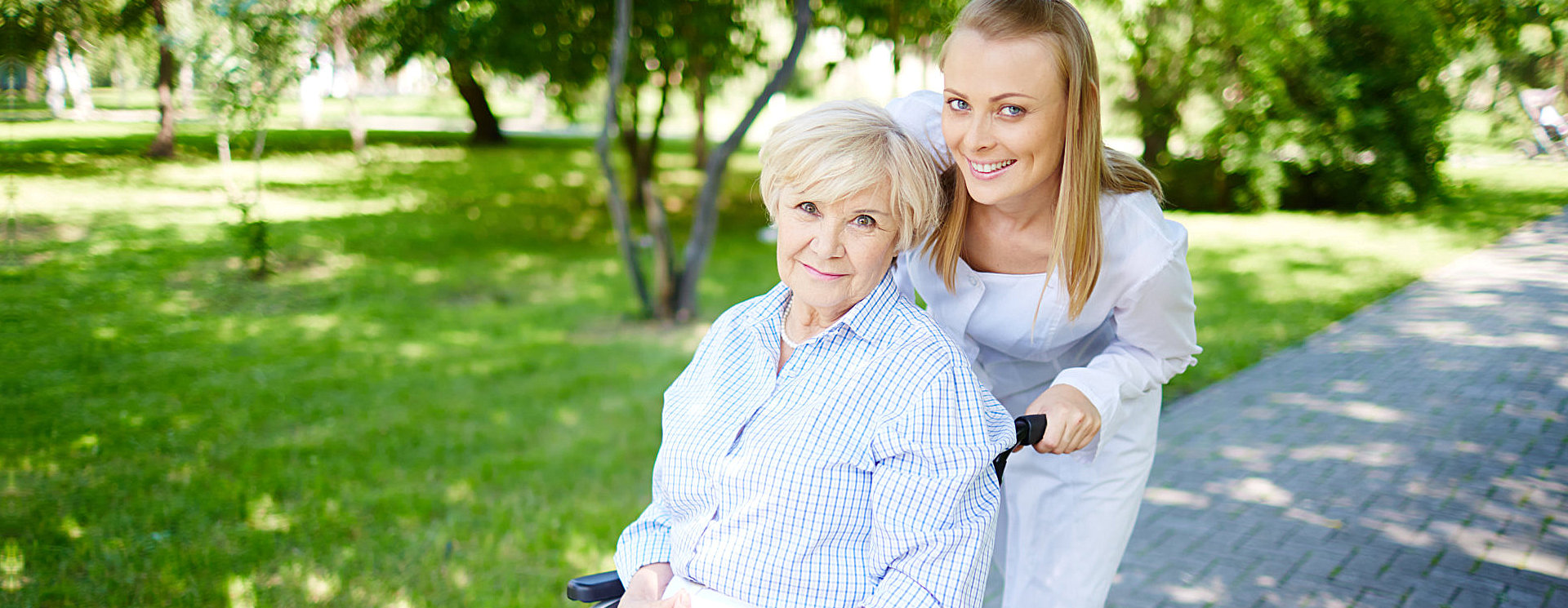 caregiver with her patient strolling in the park