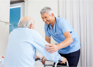caregiver assisting his patients in standing