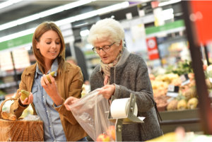 caregiver assisting her patient in buying grocery