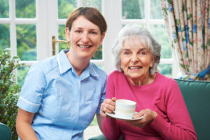 caregiver with her patient having a coffee