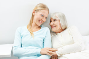 caregiver with her patient hugging