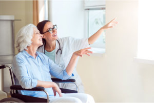 caregiver with her patient pointing something
