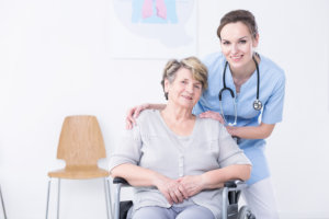 medical staff and her patient smiling