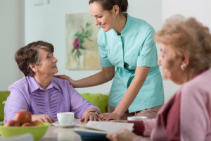 caregiver serving her patients