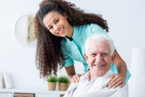caregiver comforting her patient