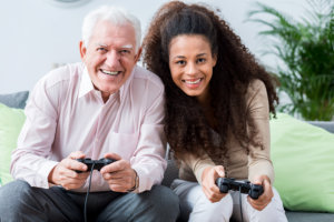 caregiver with her patient playing console game